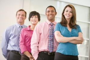 Business team standing indoors smiling